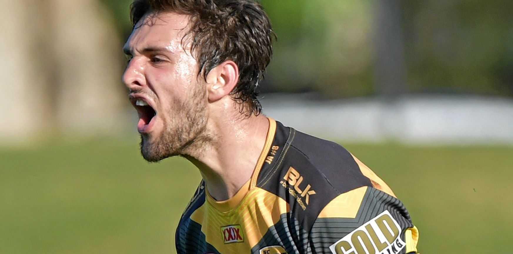 HEAR ME ROAR: Sunshine Coast Falcons winger Sam Young celebrates scoring a try.