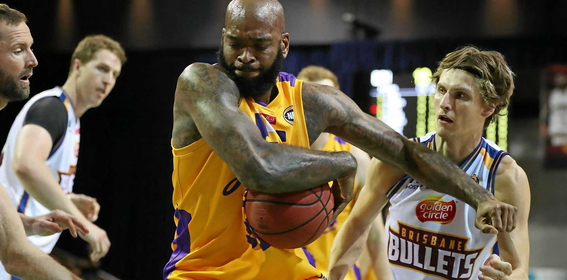 Josh Powell of the Kings takes a rebound against the Bullets at the Brisbane Convention and Exhibition Centre.