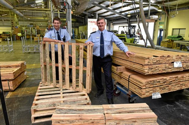 Maryborough Correctional Centre - (L) Michael Sunderland (Correctional Mgr. Prison Industries) and General Mgr. Darryll Fleming in the wood workshop with timber pallets made by prison inmates.