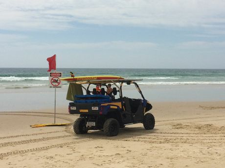 BEACH CLOSED: Lifeguards close Coolum Beach after a shark sighting.