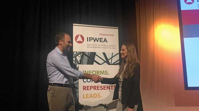 Jessica engages with industry reps at IPWEAQ conference.