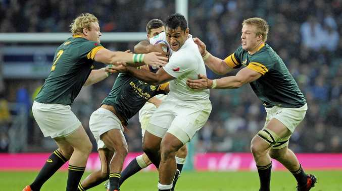 England's Billy Vunipola is tackled by South Africa's defence at Twickenham.