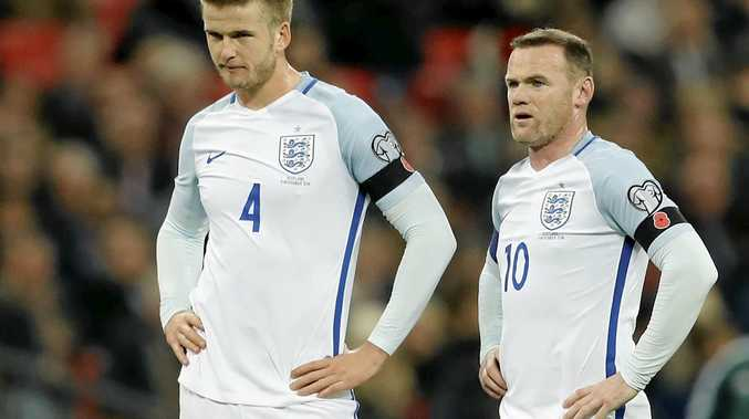 England's Eric Dier and Wayne Rooney wait to tack free kick during the World Cup 2018 Group F qualification match against Scotland at Wembley.