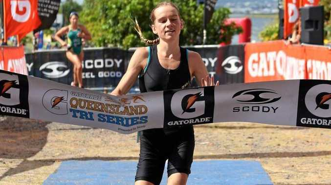 WINNING: Romy Wolstencroft, 17, crosses the line first at the Round 3 of the Queensland tri Series Kawana yesterday morning.