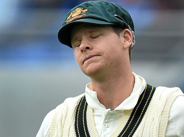 Australian captain Steve Smith reacts after failing to stop a South African boundary on day one of the second Test in Hobart.
