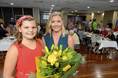 Violet Davies presents MC Katie Brown with a bunch of flowers at the annual Clarence Valley Sports Awards at the Grafton District Services Club on Saturday night, 12th November, 2016.