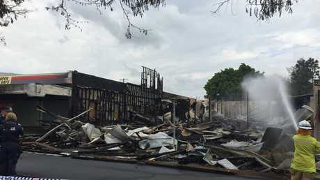 Firefighters keep control of the Imperial Hotel in Gatton late last year.
