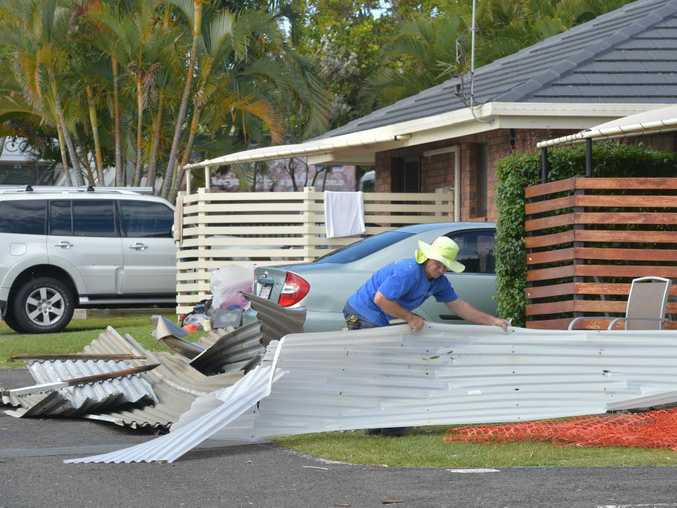 Cleaning up after the Dicky Beach storm on Sunday night.Residents hid in their homes at the Dicky Beach Caravan Park during the storm.