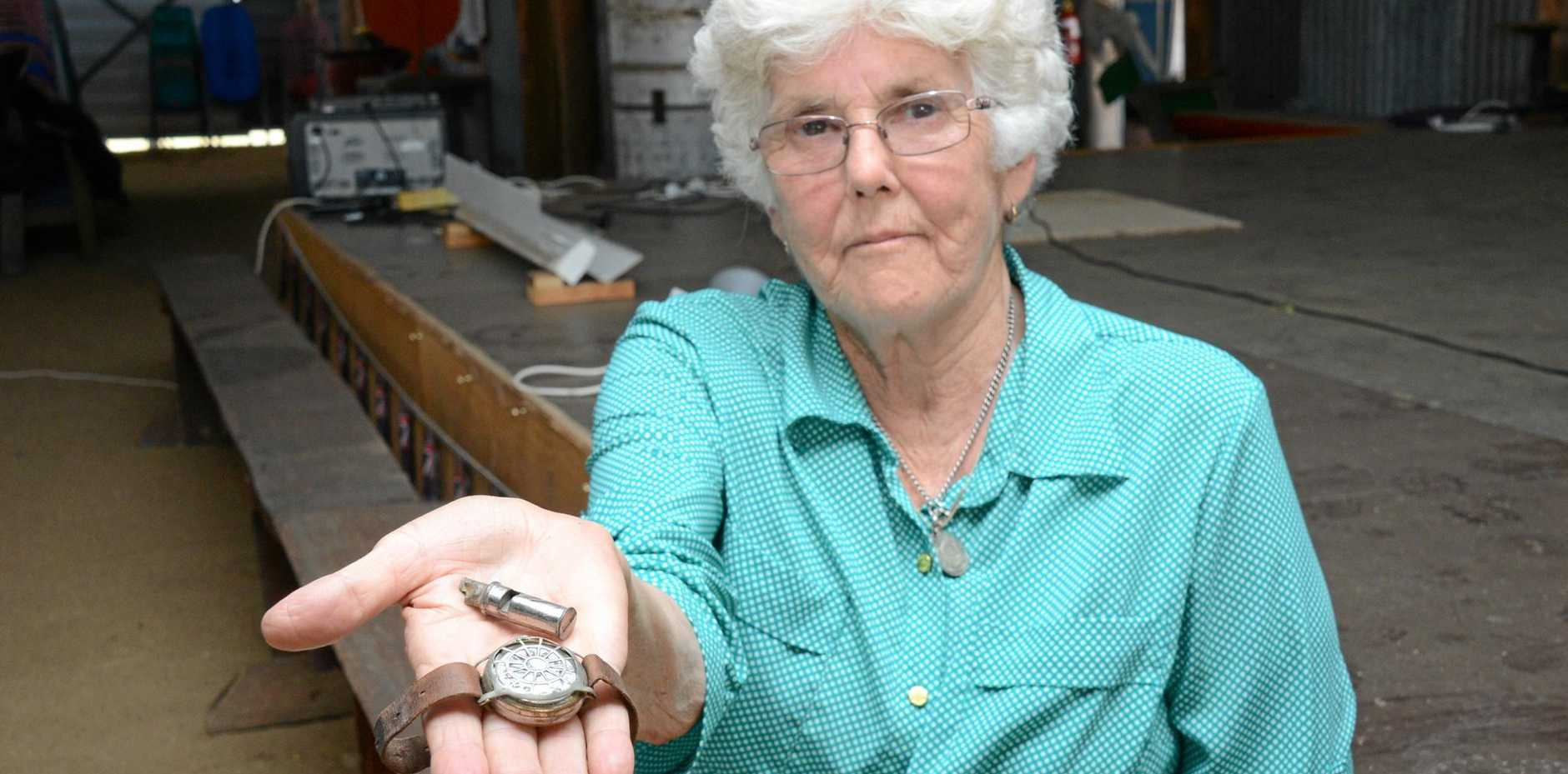 PRIZED POSSESSIONS: Barbara Brazier holding the watch and whistle that belonged to the late Arthur Brazier.
