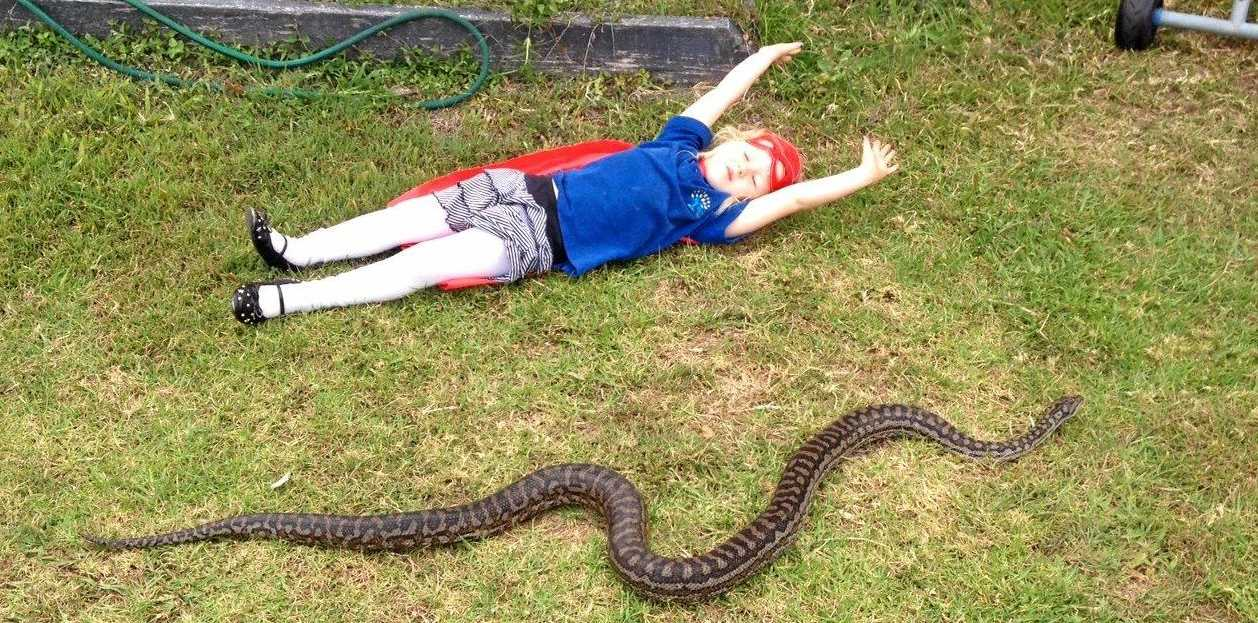 Caroline Harris' pet python Sylvanna is missing. Pictured here with 4-year-old Elizabeth.