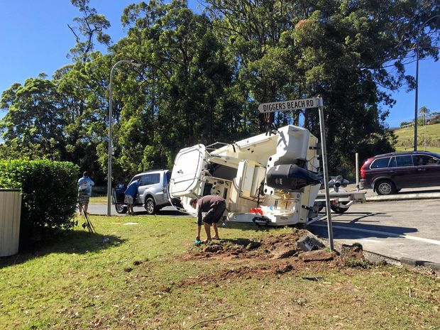 TIPPED OFF: A boat was rolled off its trailer after the driver hit a kerb at Diggers Beach Rd, Coffs Harbour this morning.