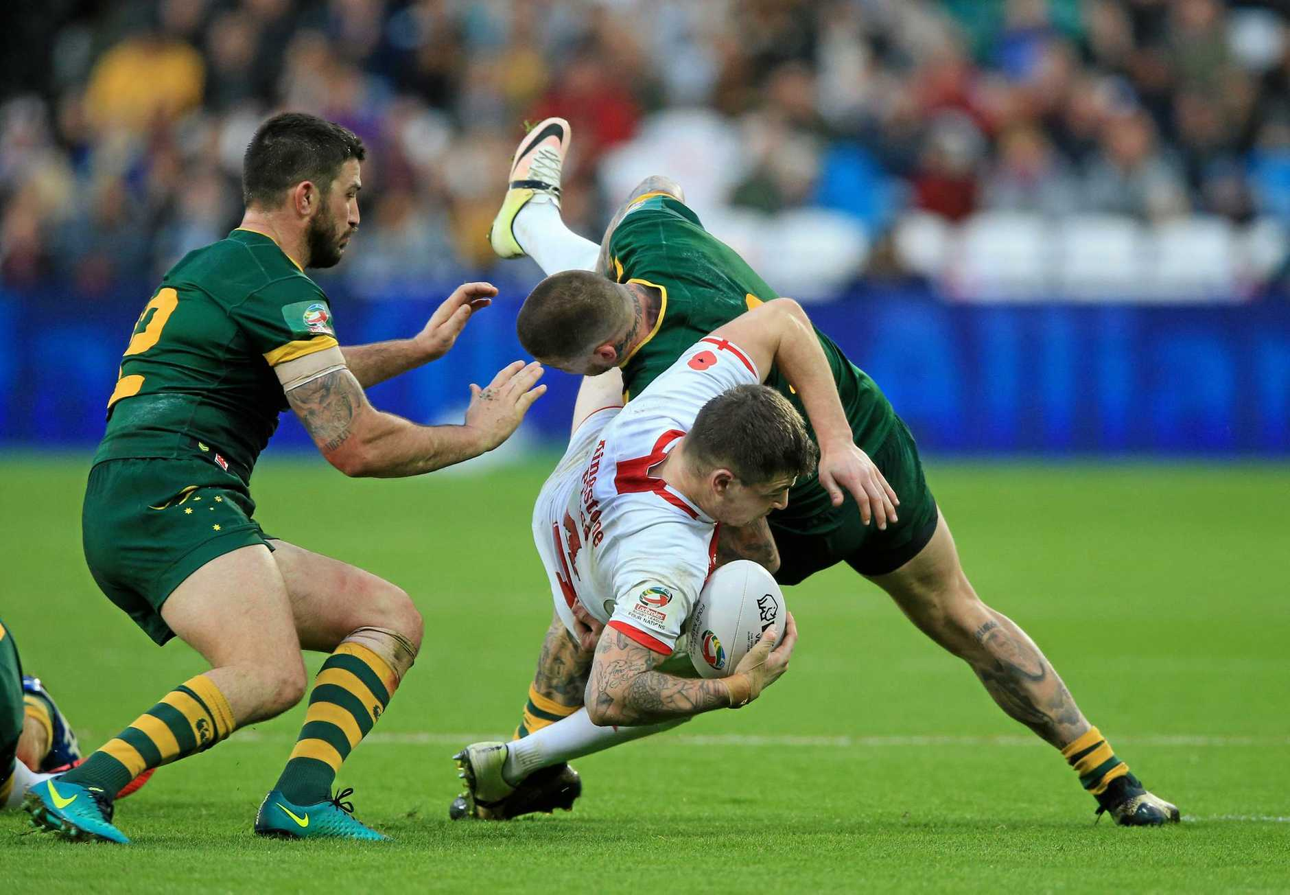 England's Mark Percival, center, is tackled by Australia's Josh Dugan, right, during their Four Nations rugby league match at London Stadium in London, Sunday, Nov. 13, 2016. (Nigel French/PA via AP)