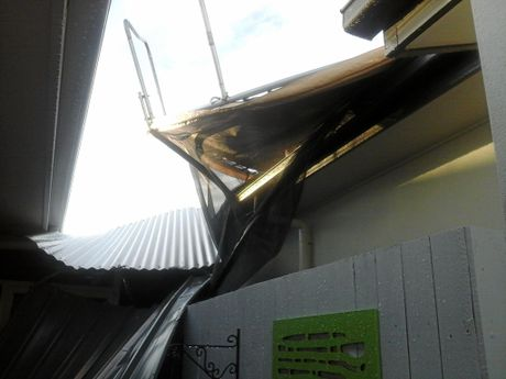 A trampoline ended up on the roof of Tim and Jenny Bell's Birtinya home