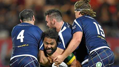 Australia's Sam Thaiday is tackled by Scotland's Luke Douglas, rear, Kane Linnett, left, and Sheldon Powe Hobbs, right, during the Four Nations rugby league match Scotland versus Australia at the KC Lightstream Stadium, Hull, England, Friday Oct. 28, 2016. (Dave Howarth/PA via AP)