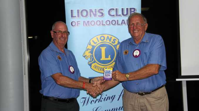 Lion Dean Farrow and Lion Fred Smedley accept the award for Exemplary Per Member giving more than $250 for each member to charities.