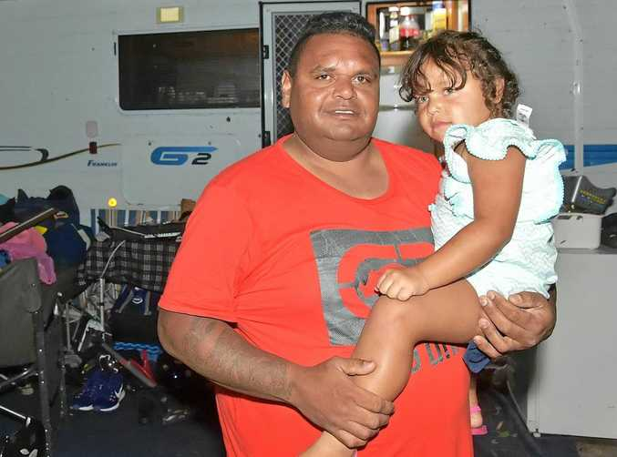STORM DAMAGE: Dennis Coolwell and his daughter Havana, 3, are glad they are safe after a harrowing night at Dicky Beach Caravan Park.