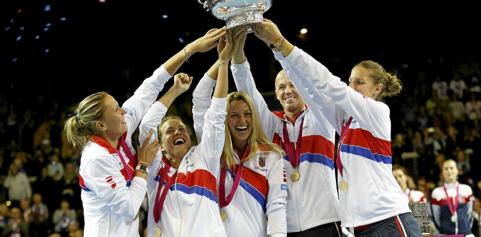Czech Republic players lift the cup after their victory against France in Strasbourg.