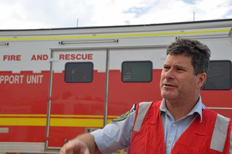 Rural Fire Service Queensland regional manager Brian Smith explains how crews are battling blaze at New Zealand Gully Rd, Mt Chalmers.