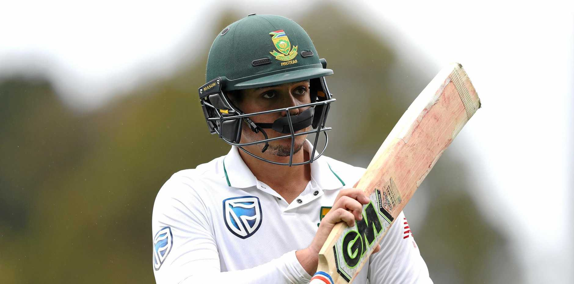 PLAYING FOR KEEPS: Quinton de Kock of South Africa walks off the ground after notching his century.