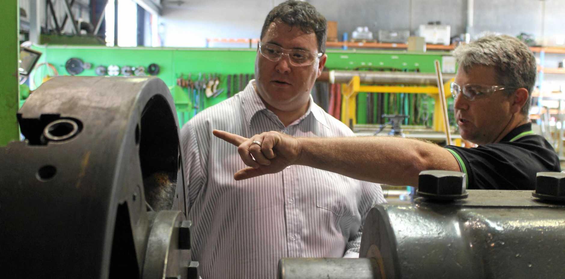 Dawson MP George Christensen tours Mackay Conveyor Equipment's Paget workshop with managing director Jason Kelly.