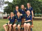 Bargara State School seniors Connor Dwyer, Shae Keith, Keely Hansen, Cody Davis, Jack Woods and Heloise O'Kelly on the school's Buddy Bench, crafted by the Bargara Men's Shed and donated by Burnett MP Stephen Bennett.