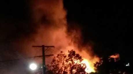 Flames rise from the Mill Street Tavern. Photo Deborah Kent