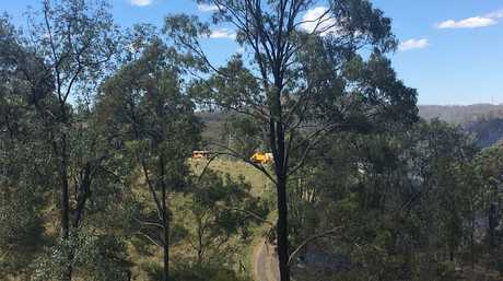 A fast-moving grass fire threatened a house in the Lockyer Valley.