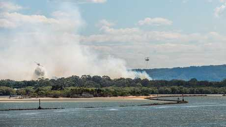 Jed Grace took these photos of the fire at South Ballina on Monday.