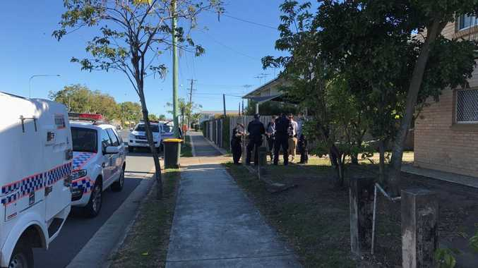 Police officers on scene at Milton St in Mackay where a man was found dead.