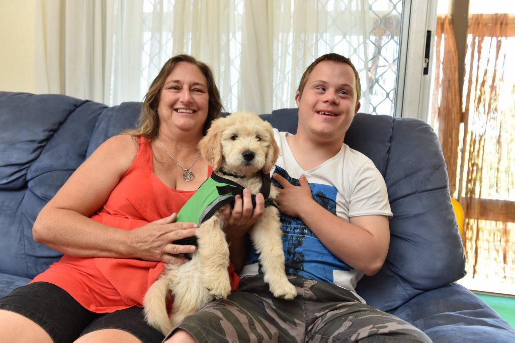 Deanne Scottt and her son, Ashlee Roberson,17, with his diabetic alert service dog, Kai.
