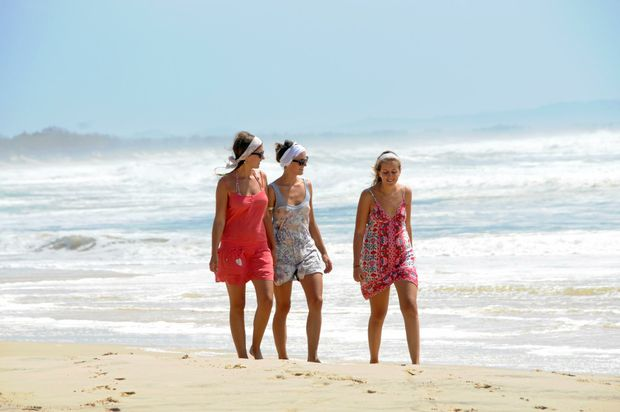 CAREFREE: German backpackers  at Rainbow Beach. They are just some of the 100,000 visitors who pass through the Gympie region each year.