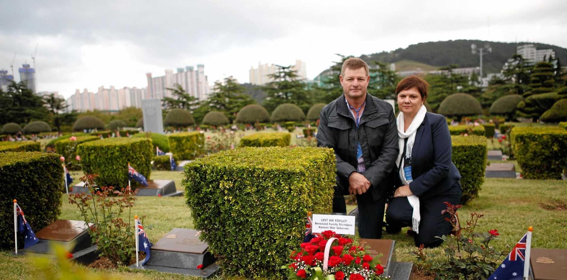 SOMBRE REUNION: Peter and Michelle Siebenhausen visit the grave of Lance-Corporal Norman Siebenhausen in Pusan, South Korea.