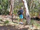 BUSTING: A walker up Mount Coolum desperately searches for a loo.