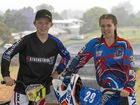 TALENTED RIDERS: World champion in 11 years boys Tom Tucker of Pine Rivers BMX Club and Toowoomba's 13 years girls competitor Maddison Groves take a break as rain interrupts the Toowoomba BMX Club open day.