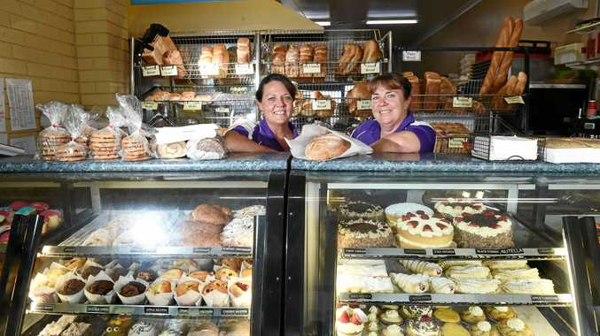 YUM, YUM: Mullumbimby Bakery employees Kimberley Hambly and Cathy Robb stand in front of the wide selection of cakes and bread at the local store.