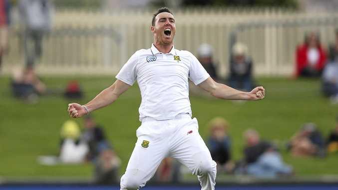 South Africa's Kyle Abbott celebrates the last Australian wicket in Hobart.