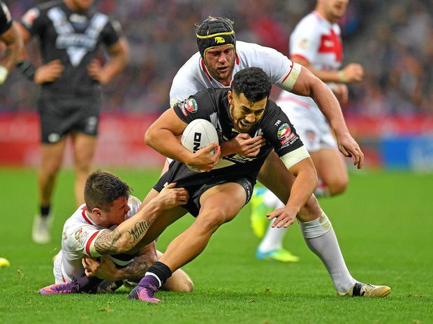 New Zealand's Jordan Kahu is tackled by England's Chris Hill and John Bateman.