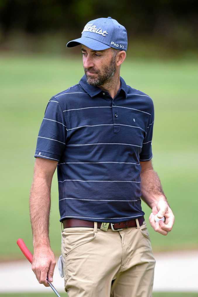 Australian Geoff Ogilvy walks off a green during practice for the Australian Open at the Royal Sydney Golf Club.
