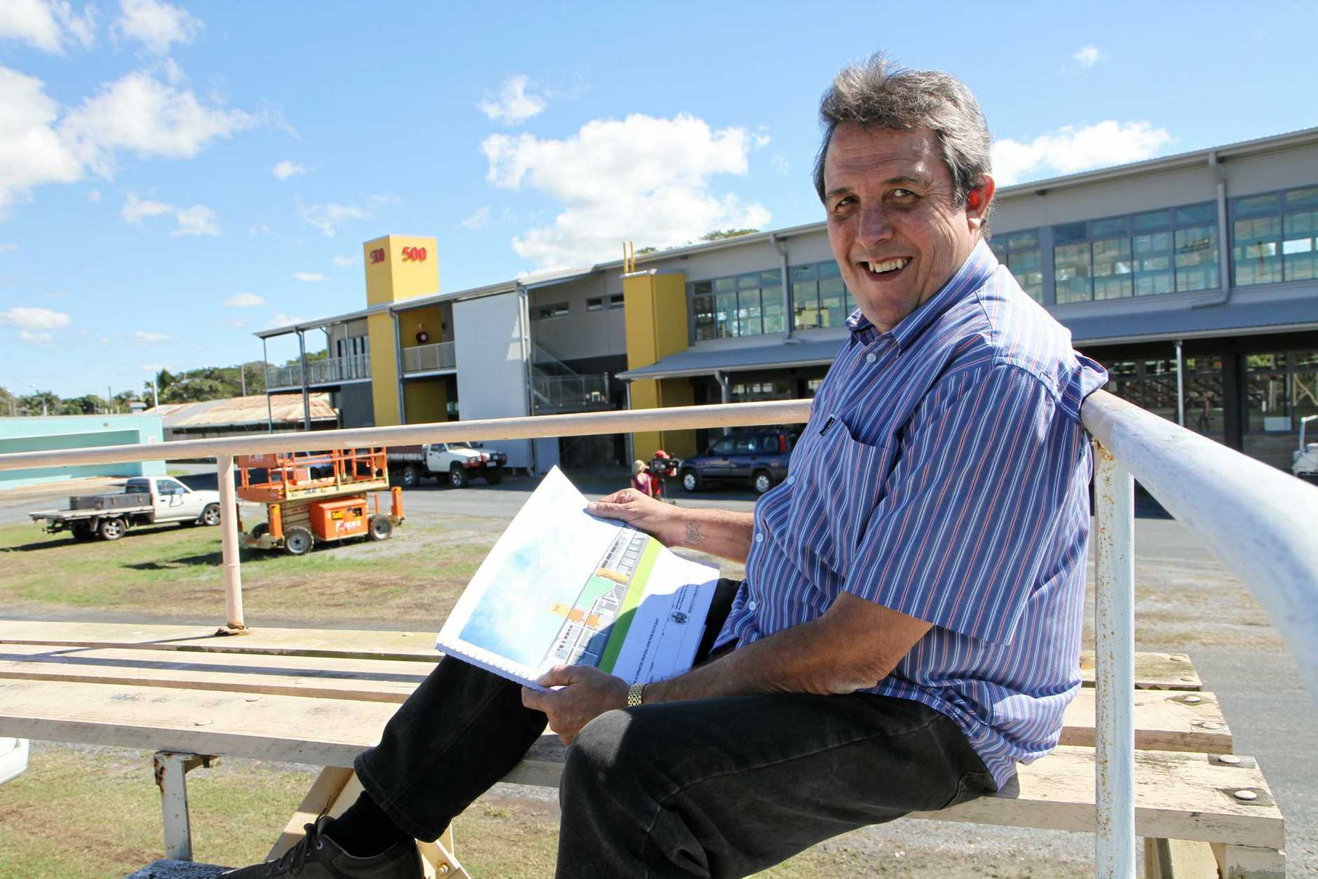 Steve Gavioli looks over the plans of the almost completed 500 Pavillion at the Mackay Showgrounds. Photo: Lauren Reed / Daily Mercury