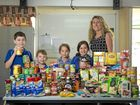 GROCERY GOODIES: Gladstone West State School students Jack Hunter, 8, Josh Bell, 5, Chloe Wilson, 7, Finlae Harris, 10 with guidance officer Jodie Cook behind the enormous effort of groceries donated by kids at the school to go towards the Uniting Care Church.