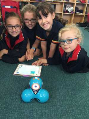 St Hilda's School Junior School students participate in coding challenges that make the Dash robots move through an obstacle course and talk.