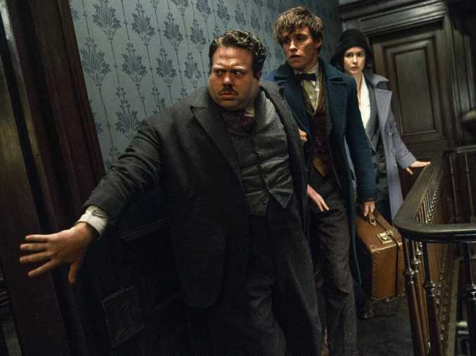 Dan Fogler, Eddie Redmayne and Katherine Waterston in a scene from the movie Fantastic Beasts and Where To Find Them.