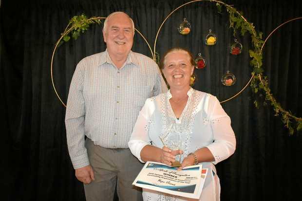 HOPE: Job Match's Garry Davison presents the Community Organisation award Ruth Polley from Hope Reins.