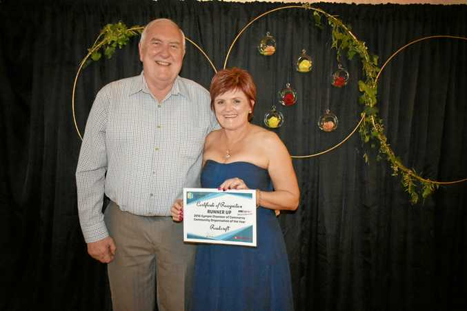 ALL SMILES: Garry Davison presents Sharlene Makin of Roadcraft with the runners-up prize.
