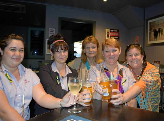 RIGHT ON TIME: Gympie finance workers getting a taste knocking of work on time from left: Yvonne Medley, Emma Portugaller, Chantelle Pinkerton, Trish Clark and Dolly Jensen.