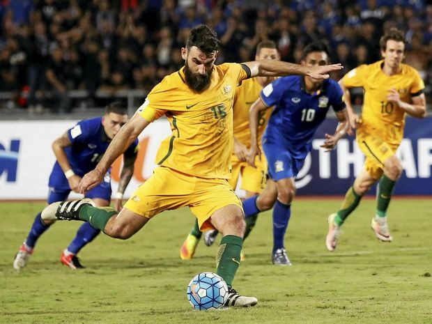Australia's Mile Jedinak scores the equaliser from the penalty spot against Thailand in Bangkok.