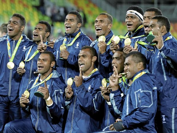 Fiji players show off their gold medal after defeating Britain in the men's rugby sevens at the 2016 Rio Olympics.