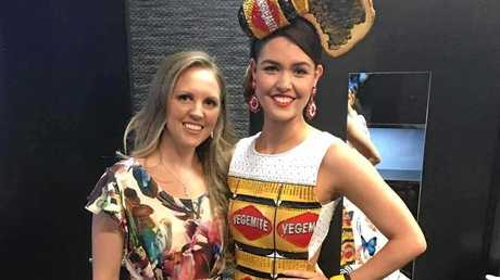 FINGERS CROSSED: Marcoola-based clothes designer and maker Megan Dive, Studio Evolve founder, has made a Vegemite dress for Miss World Australia - worn here by model Danielle Pierce. It's been selected as one of four finalist Australiana-themed dresses.