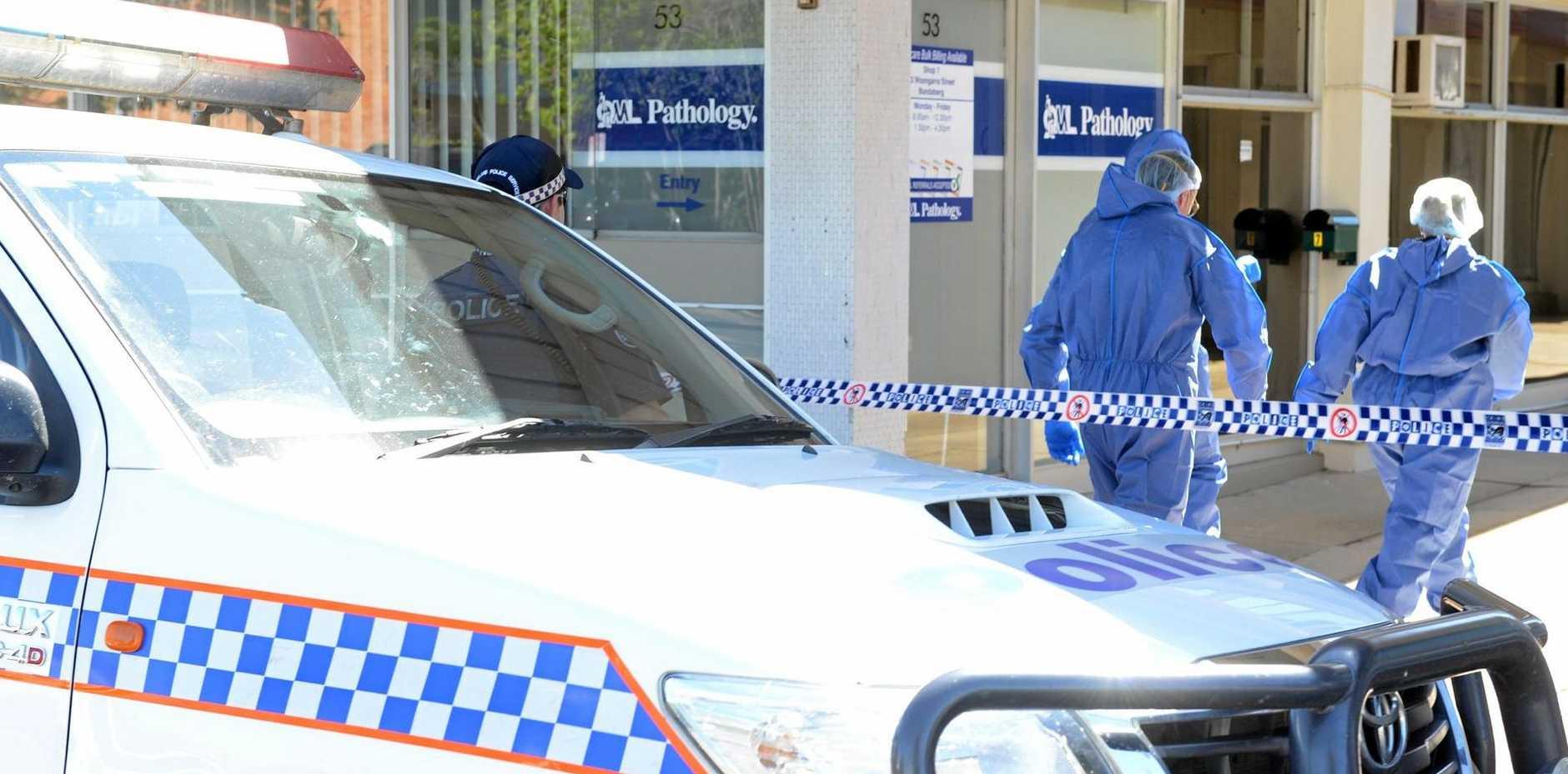 CRIME SCENE: Police arrive at the Bundaberg CBD to investigate.