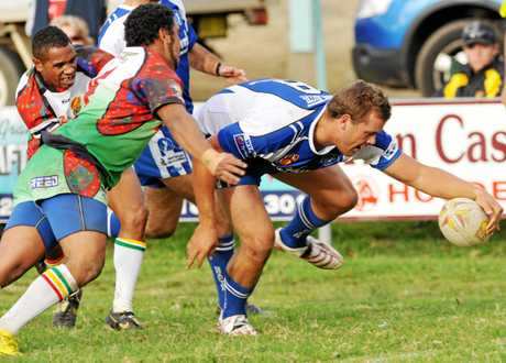 Danny Wicks crashes across for a try against Northern United Dirawongs back in his days playing first grade for the Grafton Ghosts.